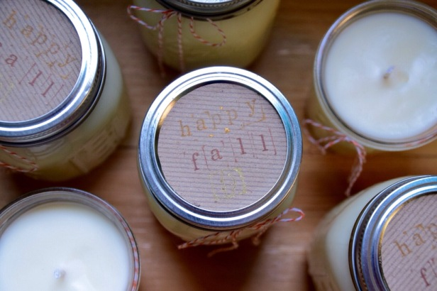 """Fall candles. I recently made a batch of pumpkin-soufflé-scented soy candles and they smell divine. If you're interested in making your own, check out my how-to here. I used pint-sized mason jars and spruced them up with bakers' twine, wrapping paper, and a friendly message - """"happy fall :)"""" - stamped in metallic ink."""
